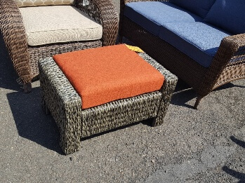 Laguna Brown All-Weather Wicker Outdoor Ottoman with Terracotta Cushion